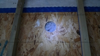 OSB with circular cut for warmcel and tescon taped Intello join